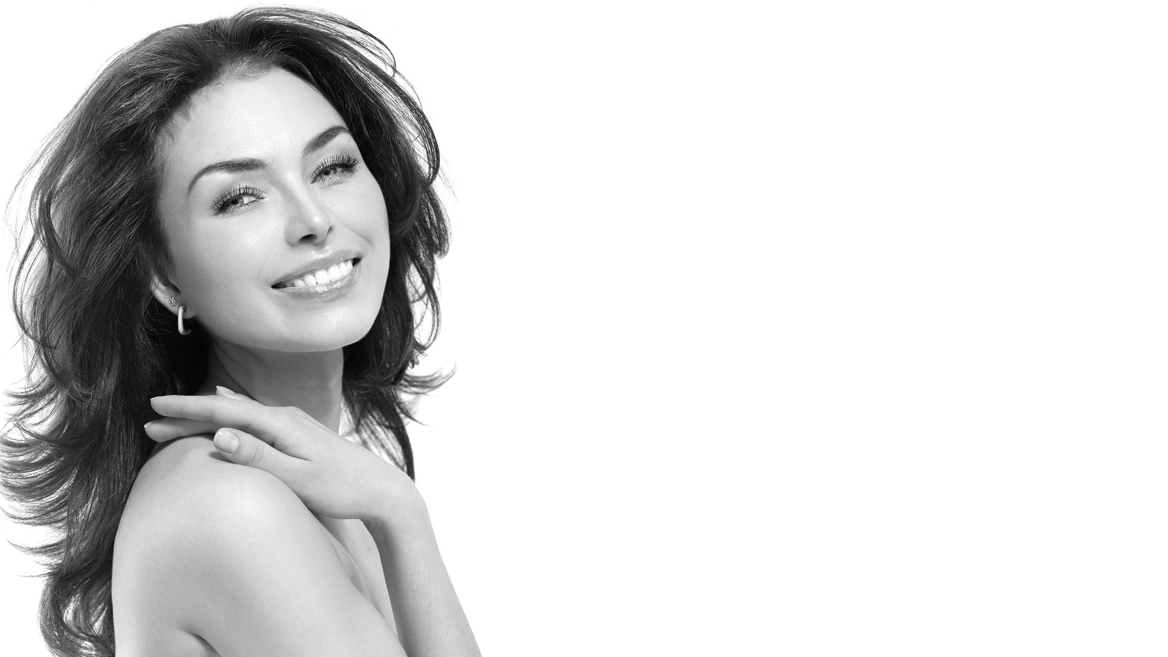 Radiant young woman at Velum Skin and Laser Center black and white