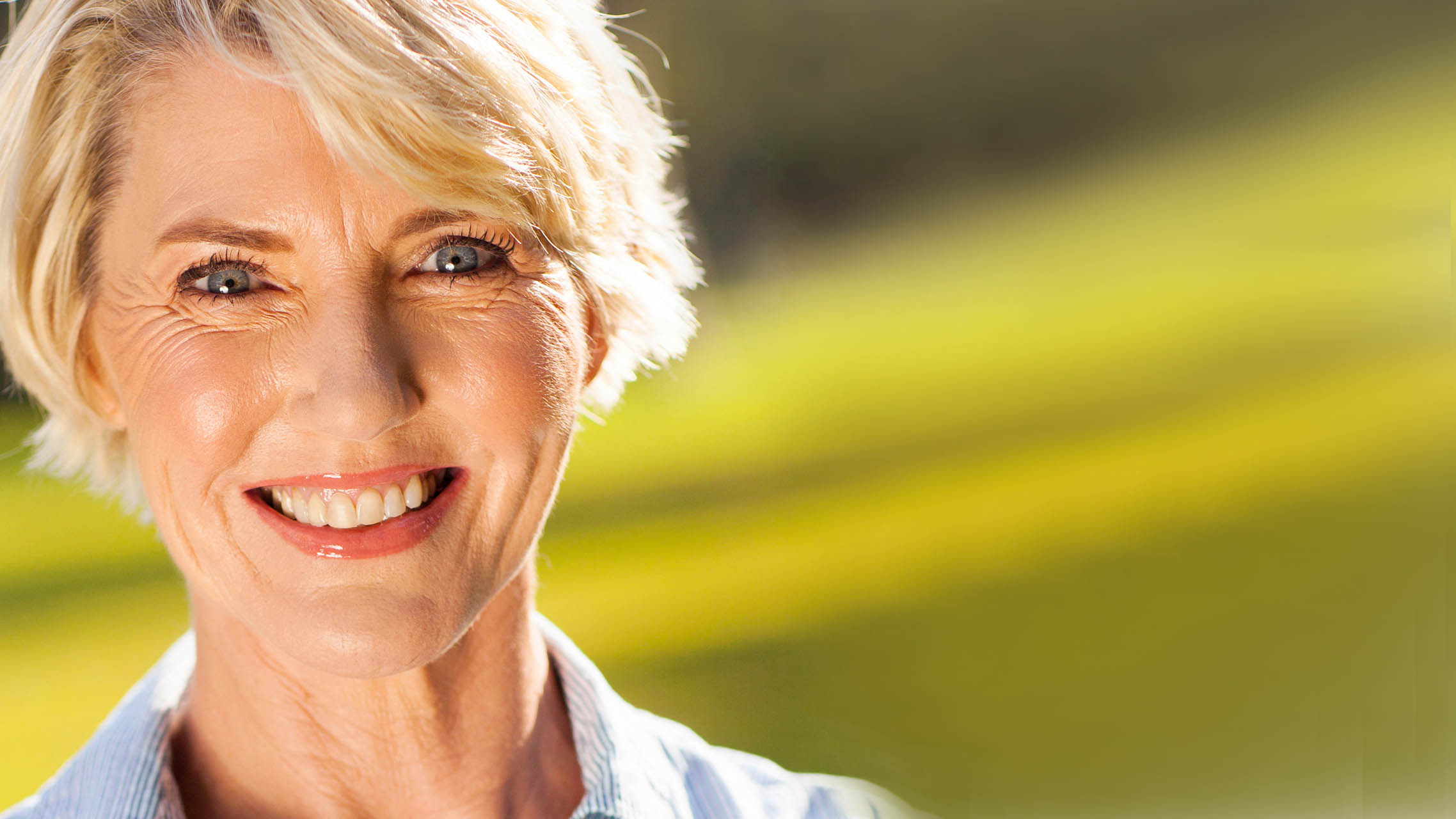 Middle aged woman smiling headshot