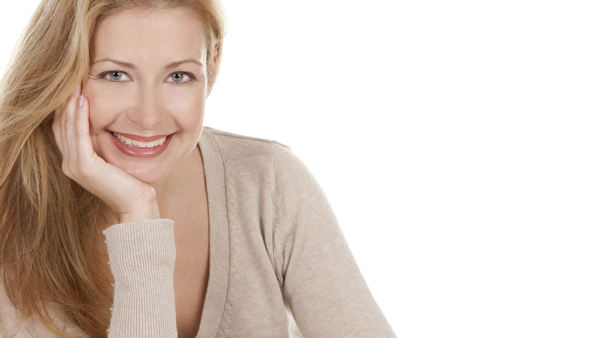 Big bright white smile headshot with a beautiful blond woman