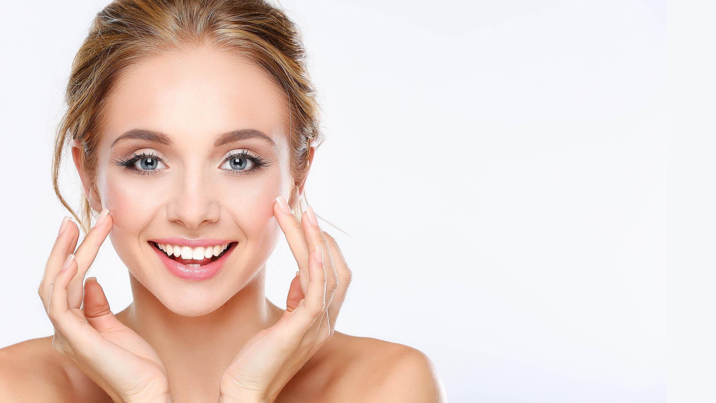 Young woman smiling glowing skin